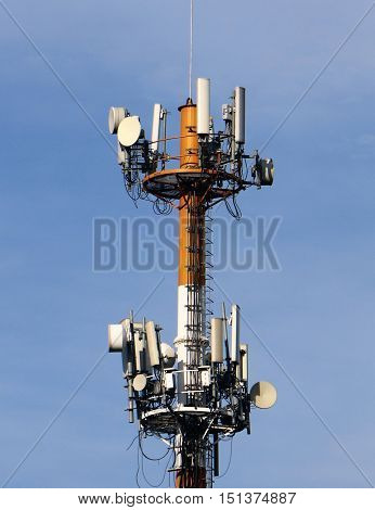Telecommunication broadcast tower under clear blue sky