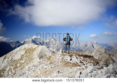moutain hiker is standing on the top of a mountain