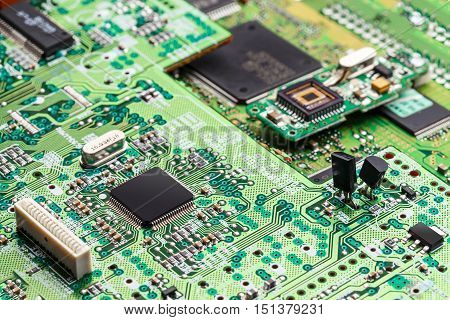 Electronic circuit microchip on green board, close up shot