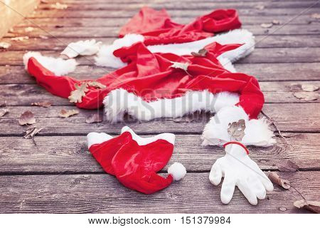 Santa Suit Abandoned On A Wooden Floor