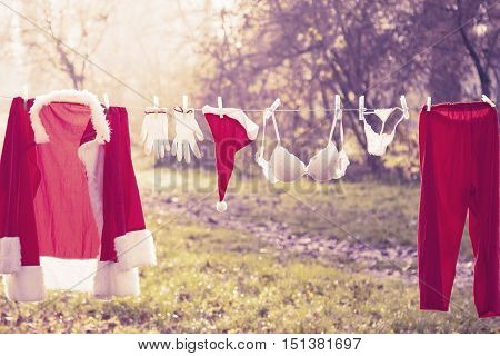 Santa Claus Suit Hung Out To Dry Mixed With Lingerie