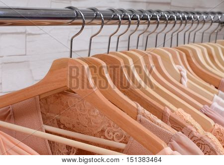 Row of female dress with coat isolated on hanging in store