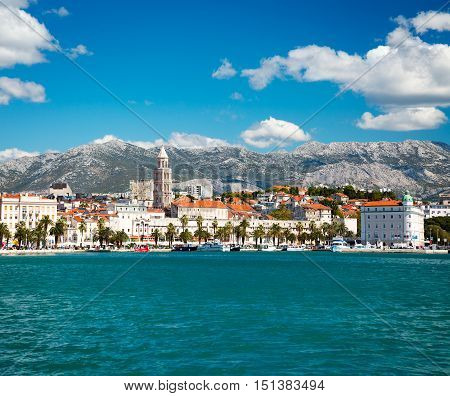 View of Riva and Old Town Split in Dalmatia region, Croatia. Ancient Diocletian's Palace. Popular Tourist Destination at Adriatic Sea. Mediterranean Europe Travel Concept.