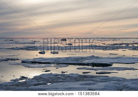 Arctic Sunset over Floating Ice Floes travel on icebreaker