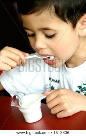 Enjoying A Pot Of Plain Organic Yogurt.