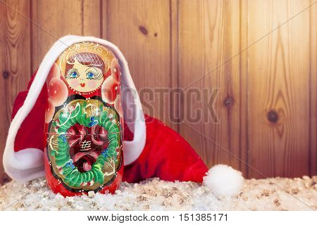 Matryoshka Covered By Christmas Hat Warm Look Filtered