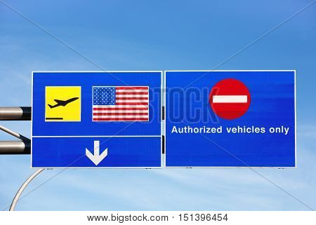 Airport direction signs for United States departures and authorized vehicles only.
