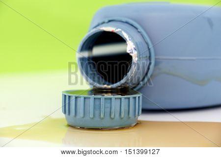 picture of a motor oil bottlecap shot in a studio