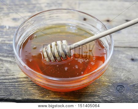 dish of honey on a wooden board