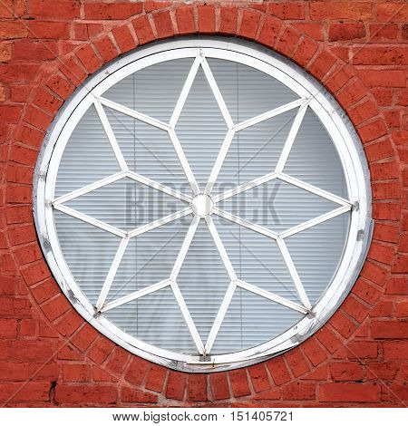 Old round window with brick wall background