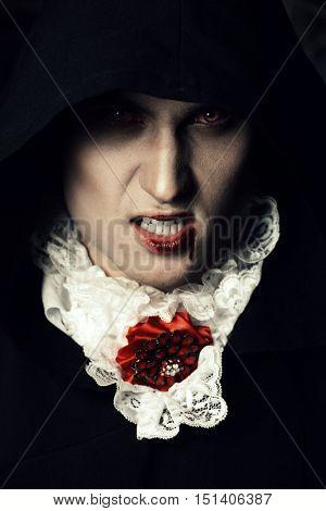 Bloodthirsty vampire grins. Halloween.