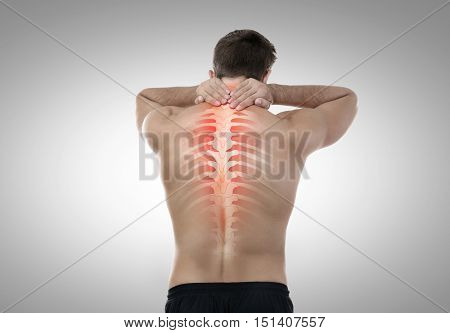 Man with neck pain on grey background