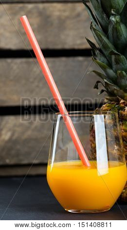 Fresh pineapple and glass with pineapple juice