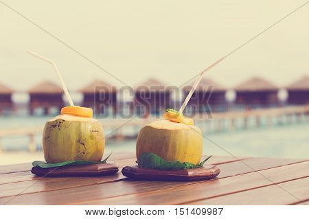 two coconut drinks on luxury tropical resort in Maldives