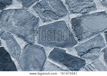 stone mosaic of a floor or wall closeup for textured abstract background and for wallpaper of silvery color