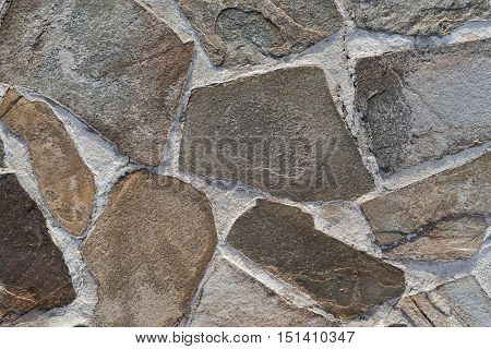 stone mosaic of a floor or wall closeup for an abstract background and for wallpaper of spotty color