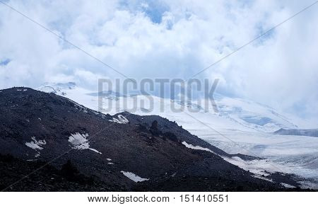 Snow-covered Mountains And Clouds