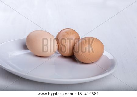 Three raw or boiled chicken eggs