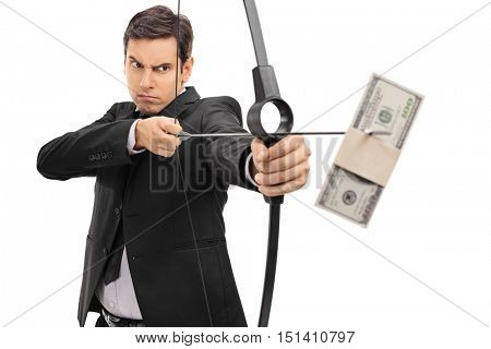 Young businessman aiming with a bow and arrow with a money bundle isolated on white background