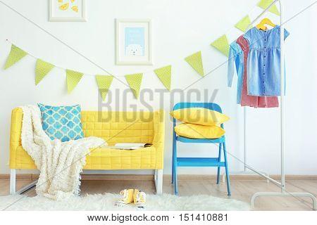 Modern room interior with yellow sofa