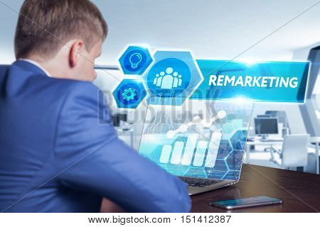 Business, Technology, Internet And Networking Concept. Young Businessman Working On His Laptop In Th
