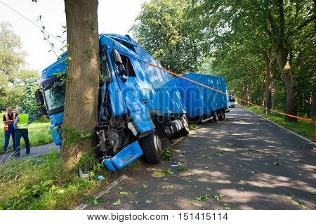 VREDEN GERMANY - JULY 21 2016: A truck crashed against a tree on a small road outside the city.