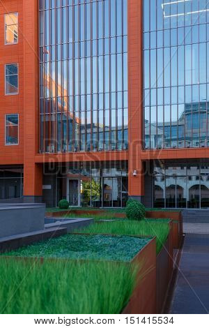 contemporary business center with decorative flowerpots in front of entrance
