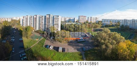 MOSCOW RUSSIA - OCTOBER 2016: Kapotnya 5 Kvartal and 4 Kvartal outskirts of UVAO Moscow Russia. Autumn view of city district Dixi shop parking and scool stadium.