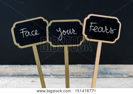 Motivational Message Face Your Fears Written With Chalk