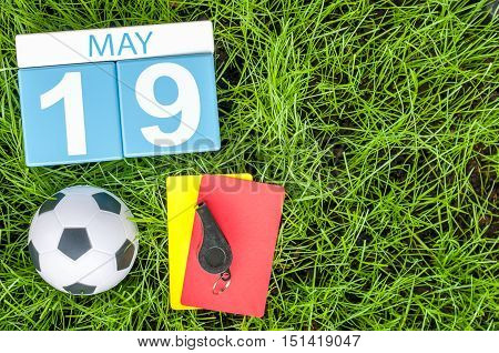 May 19th. Day 19 of month, calendar with football green grass background. Spring time.