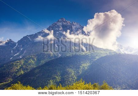 Fantastic snow peaks of Mt. Ushba in the morning light. Picturesque and gorgeous scene. Location place Svaneti, Mestia, Georgia, Europe. High Caucasus ridge. Artistic picture. Beauty world.