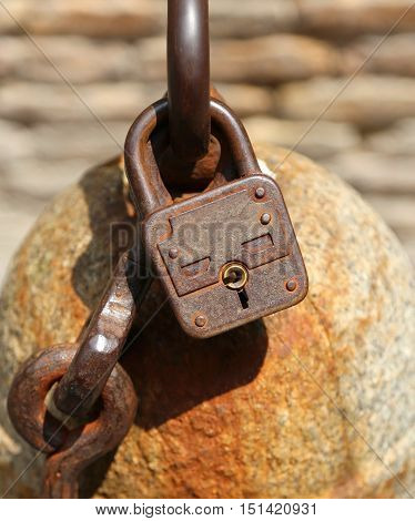 Rusty Padlock To Lock A Chain