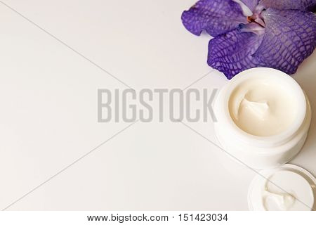Still Life With Cream Jar And Flower On White Background.