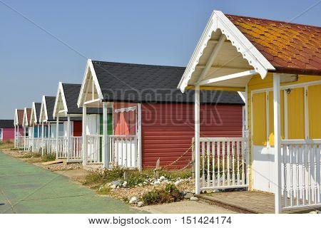 Colourful painted beach huts at Lancing (near Brighton) in West Sussex England
