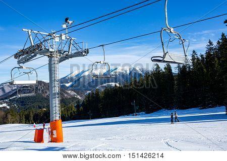 ski chair lift on mountain resort in nice winter day