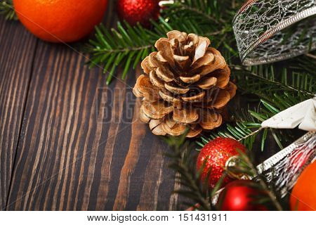 Pine cone closeup on a wooden background
