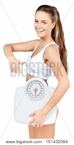 Portrait of a Fit Woman Pointing at Weight Scale