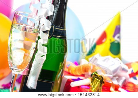 Champagne Bottle and Glass with Gift and Balloons