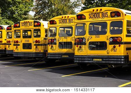 Kokomo - Circa October 2016: Yellow School Buses in a District Lot Waiting to Depart for Students V