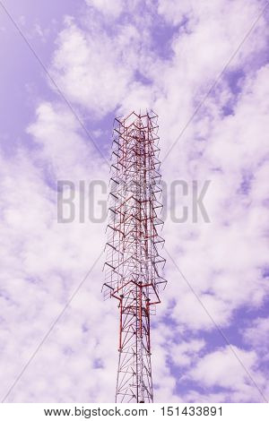 Radio or TV broadcast tower against blue sky background