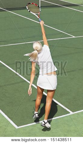 Portrait of a Female Tennis Player Smashing / Serving
