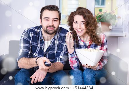 Winter Concept - Happy Young Couple Watching Tv Or Movie At Home