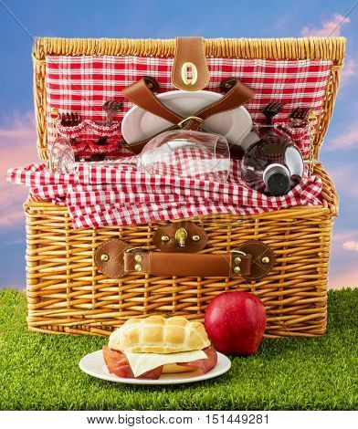 Picnic Basket With Sandwich And Apple