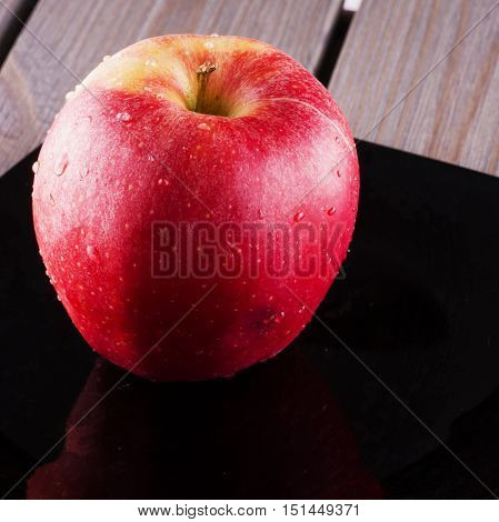 Red Apple Over Black Plate