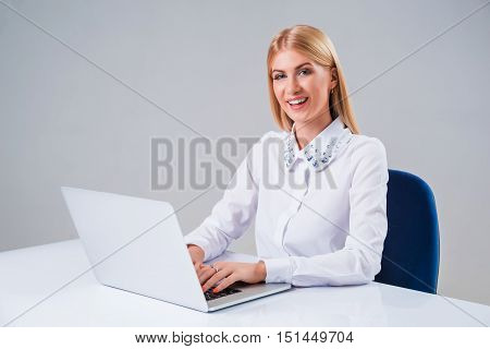 Young businesswoman working at laptop computer. she pleased, to do the work is happy