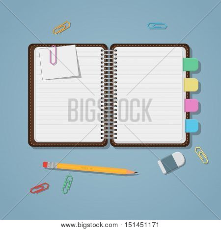 Opened notebook with colored tabs clips and pencil.