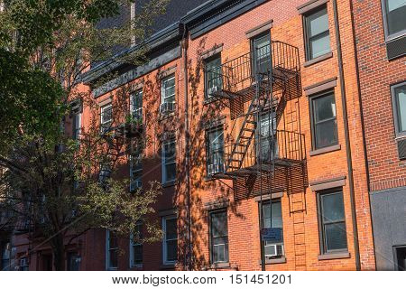 Red brick apartment buildings line a side street in Greenwich Village, Manhattan NYC
