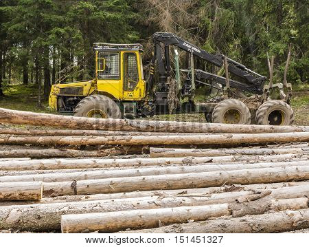 Ziar Slovakia - September 04 2016: Forwarder is a forestry vehicle that carries big felled logs from the stump to a roadside landing.