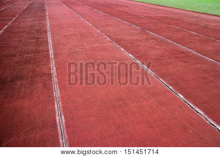 Running track lanes and field in horizontal 3:2 format.