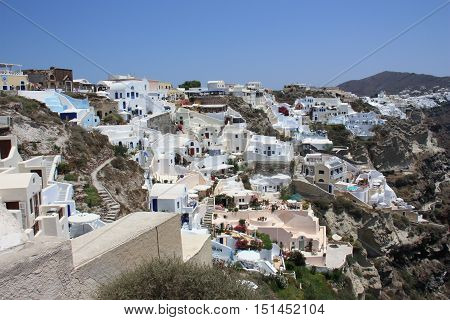 White houses with blue roofs in Santorini. Greece